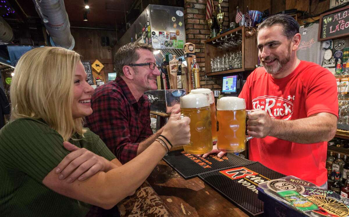 Cicerone Melissa Hildreth of the FX Matt Co., left, joins Erik Budrakey of The Brown Brewery, center and Dave Gardell at The Ruck Friday Sept. 15, 2017 in Troy, N.Y. (Skip Dickstein/Times Union)