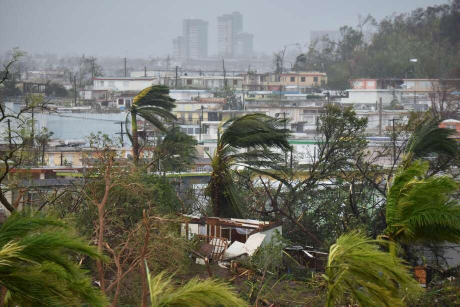 Destruction caused by Hurricane Maria close to Roberto Clemente Coliseum in San Juan, Puerto Rico, on September 20, 2017. Maria slammed into Puerto Rico on Wednesday, cutting power on most of the US territory as terrified residents hunkered down in the face of the island's worst storm in living memory. After leaving a deadly trail of destruction on a string of smaller Caribbean islands, Maria made landfall on Puerto Rico's southeast coast around daybreak, packing winds of around 150mph (240kph). Photo: JOSE ROMERO/AFP/Getty Images