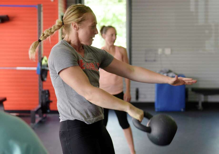 Instructor Stephanie Kosnick demonstrates a move during a kettlebell class at Founder's HIIT and Strength Club on Wednesday, Aug. 23, 2017, in Delmar, N.Y.  (Paul Buckowski / Times Union) Photo: PAUL BUCKOWSKI / 20041188A