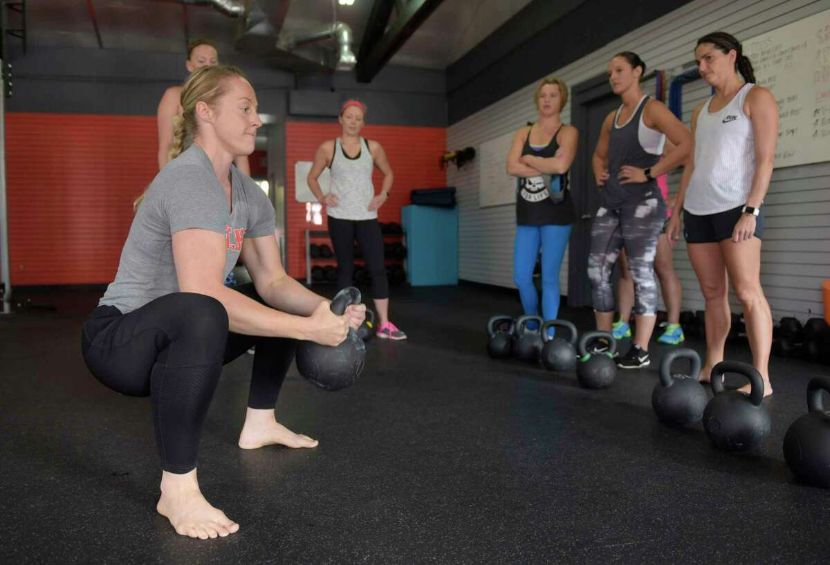 Instructor Stephanie Kosnick demonstrates a move during a kettlebell class at Founder's HIIT and Strength Club on Wednesday, Aug. 23, 2017, in Delmar, N.Y. (Paul Buckowski / Times Union)