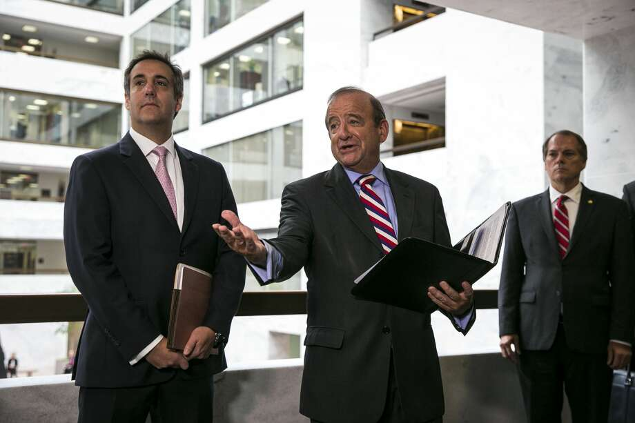 Michael Cohen, left, President Donald Trump'€™s lawyer, listens as his attorney, Stephen Ryan, center, makes a statement after a closed-door meeting with the Senate Intelligence Committee on Capitol Hill in Washington, Sept. 19, 2017. Cohen told Senate investigators on Tuesday that the president'€™s critics were using rumors and innuendo about Russian interference in the election in an attempt to undercut Trump'€™s presidency Photo: AL DRAGO/NYT