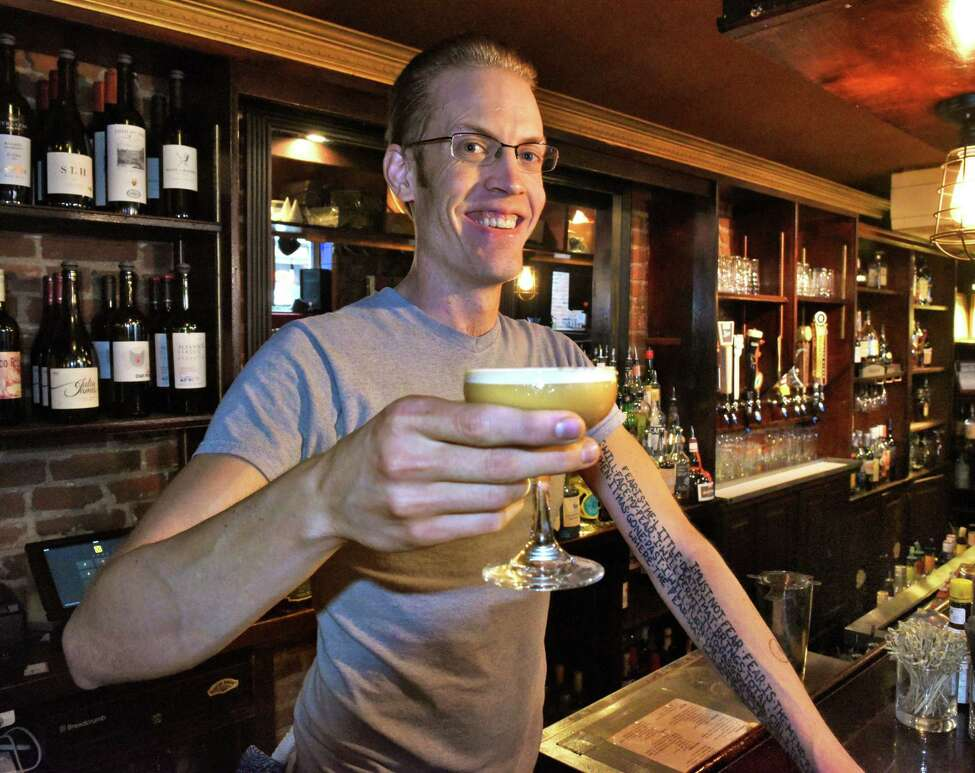 Jakob Moore with one of his Cynar Flipped cocktails at the bar of One Caroline Friday August 18, 2017 in Saratoga Springs, NY. (John Carl D'Annibale / Times Union)