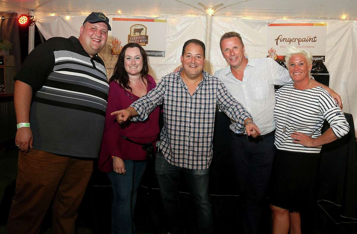 Saratoga Springs, NY - September 9, 2016 - (Photo by Joe Putrock/Special to the Times Union) - (l to r) Event Judge Tom Thibeault poses with his wife Michelle Hines Abram Thibeault and the other three event judges, celebrity chefs Josh Capon, Marc Murphy and Anne Burrell during the 16th Annual Saratoga Wine and Food Festival at the Saratoga Performing Arts Center. ORG XMIT: 07