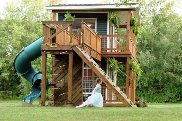 Adam Boyd of Highland, Michigan built his daughters, Avery, 5, and Violet, 2, an epic playhouse with 8-foot ceilings, a rock wall and many spaces for picture-perfect tea parties.