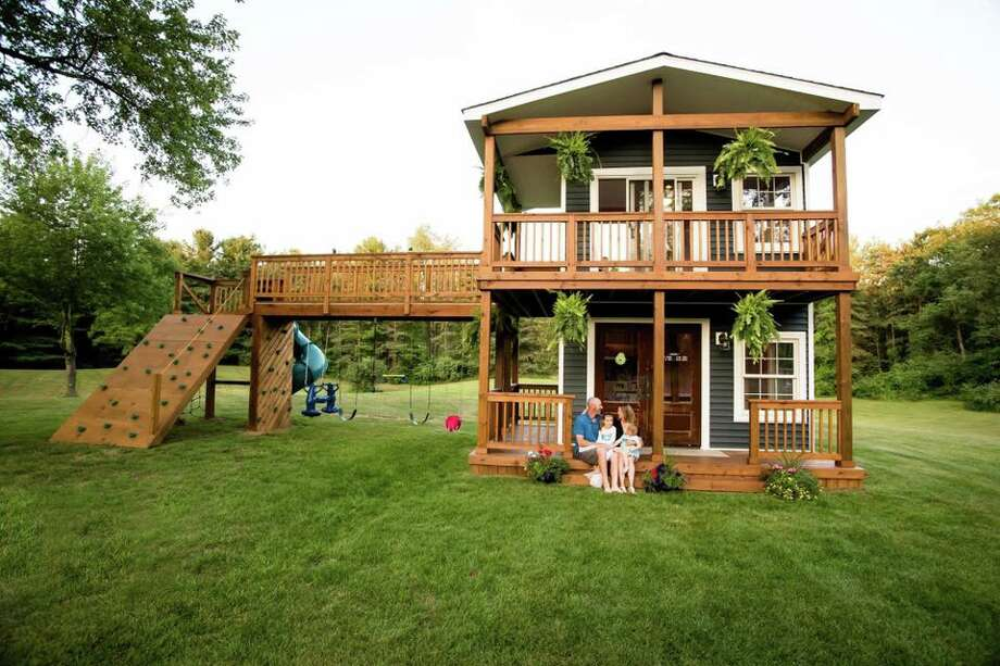 Adam Boyd of Highland, Michigan built his daughters, Avery, 5, and Violet, 2, an epic playhouse with 8-foot ceilings, a rock wall and many spaces for picture-perfect tea parties. Photo: Rachel Goldsworthy, Flashes Of Life Photography