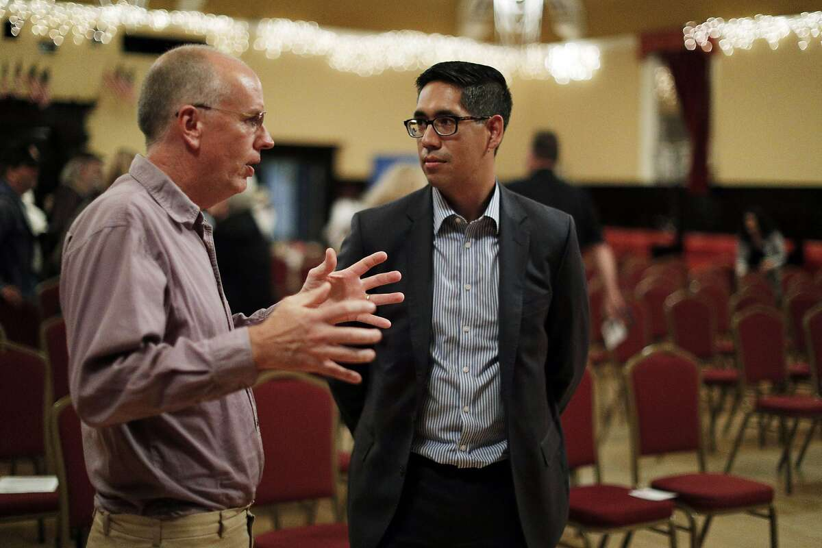 Michael Bracamontes, candidate for California Governor, speaks with member of the audience during a presentation of progressive candidates for several local elected offices at the Elks' Lodge in Alameda, on Wednesday, September 13, 2017.
