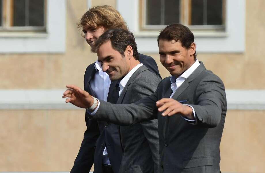 (L to R) German tennis player Alexander Zverev, Swiss tennis player Roger Federer and Spanish tennis player Rafael Nadal greet the audience from the stage ahead of the tennis Laver Cup on September 20, 2017 in Prague, Czech Republic. European players compete against players from the rest of the World during the Laver Cup tournament that runs from from September 22-24. / AFP PHOTO / Michal CizekMICHAL CIZEK/AFP/Getty Images Photo: MICHAL CIZEK, AFP/Getty Images