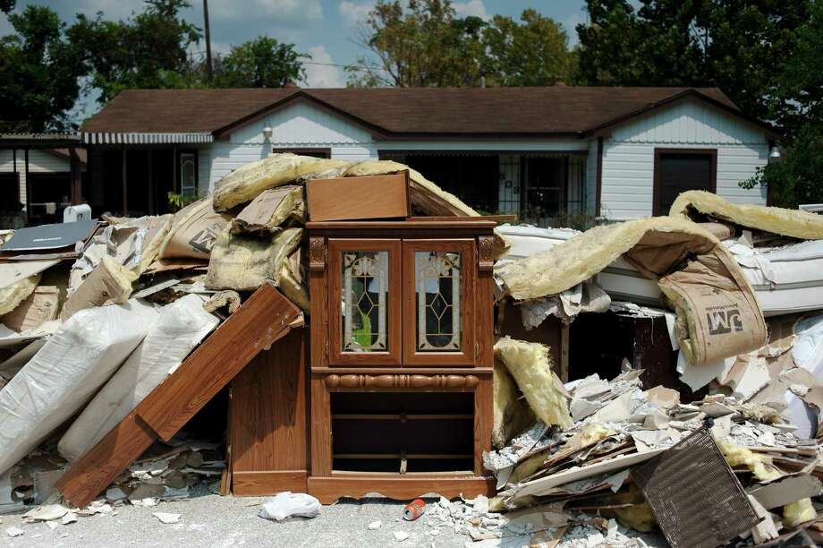 Flood-damaged insulation, furniture and other rubbish is piled outside a home in Kashmere Gardens on Sept. 2, 2017. Photo: BRYAN THOMAS, NYT / NYTNS