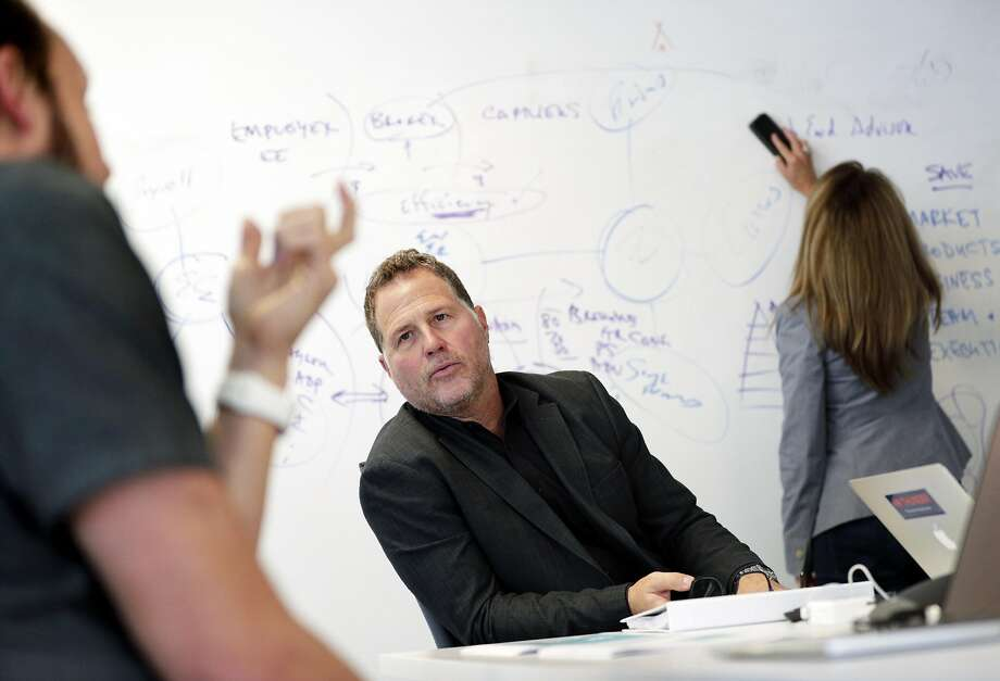 Zenefits CEO Jay Fulcher, center, in a project meeting with Kevin Marasco, Zenefits CMO, left, and Jessica Hoffman, VP of Communications, right, at the company's headquarters in San Francisco, Calif., on Tuesday, September 19, 2017. Photo: Carlos Avila Gonzalez, The Chronicle
