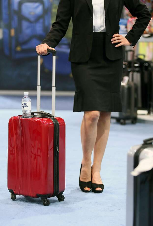 Visionair's Beverage Pal carry-on luggage has a cup holder for convenient sipping while waiting in airport lines. MUST CREDIT: Photo by Ronda Churchill for The Washington Post. Photo: THE WASHINGTON POST, The Washington Post