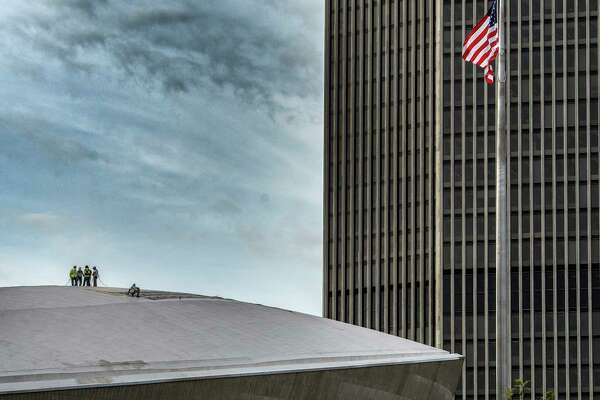 Workers involved in a forensic investigation of the roof of the Egg in Empire State Plaza Wednesday Sept. 20, 2017 in Albany, N.Y.    (Skip Dickstein/Times Union)