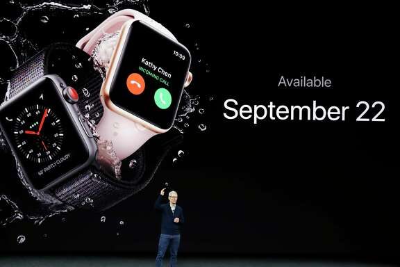 FILE - In this Tuesday, Sept. 12, 2017, file photo, Apple CEO Tim Cook talks about the new Apple Watch Series 3 at the Steve Jobs Theater on the new Apple campus in Cupertino, Calif. Apple is confirming that its new Series 3 Apple Watch has problems connecting to a cellular network. The problems arise when the watch joins unauthenticated Wi-Fi networks without connectivity. The company says it is investigating a fix for the problem. (AP Photo/Marcio Jose Sanchez, File)
