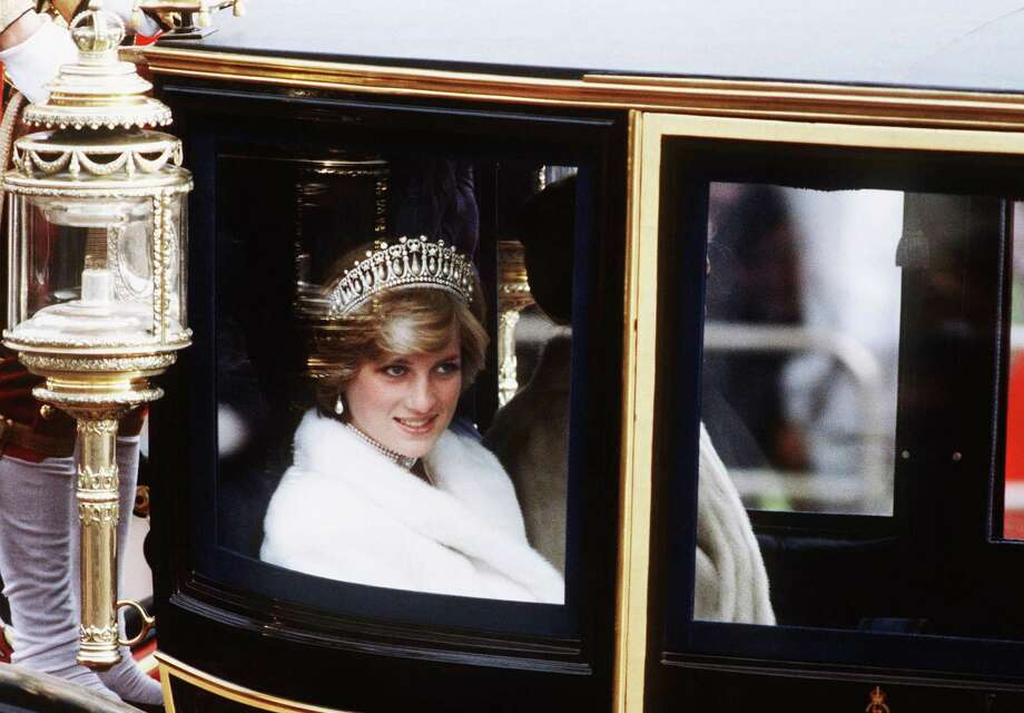 Princess Diana, Princess of Wales, on her way to the State Opening of Parliament in November 1981 in London traveling in the glass coach used for her wedding. Photo: Anwar Hussein / WireImage / 2007 Anwar Hussein
