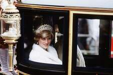 Princess Diana, Princess of Wales, on her way to the State Opening of Parliament in November 1981 in London traveling in the glass coach used for her wedding.