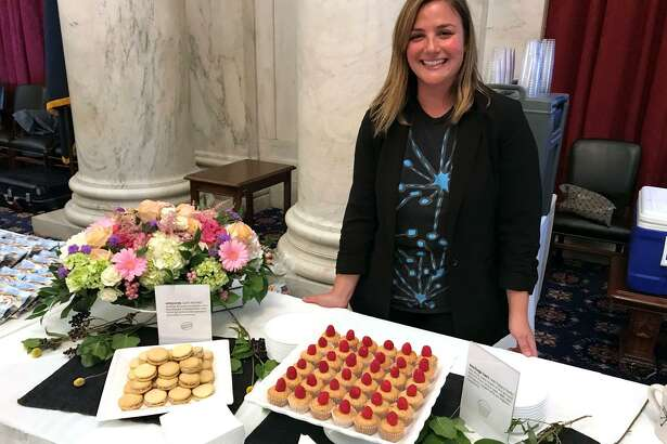Leyla Dam Jenkins, owner of Lorca, a coffee-pastry shop on Bedford Street in Stamford, displays delicacies at D.C.'s fourth annual ``Discover Connecticut,'' which showcases a host of CT drink and food producers and other businesses on Capitol Hill.