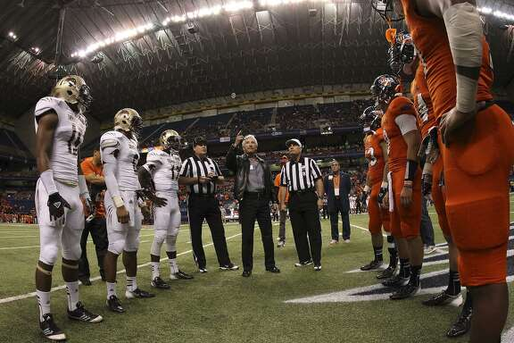 UTSA and Texas State players gather for the pregame coin toss with local businessman Ernesto Ancira before the game at the Alamodome on Nov. 24, 2012.