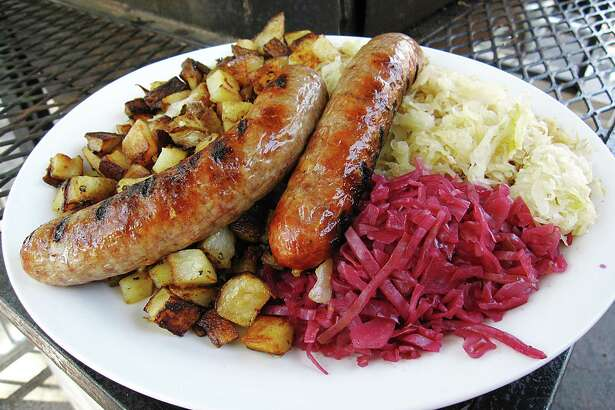 Karuse's Traditional Sausage Plate includes bratwurst from New Braunfels Smokehouse, fried potatoes, sauerkraut and red cabbage at Krause's Cafe.