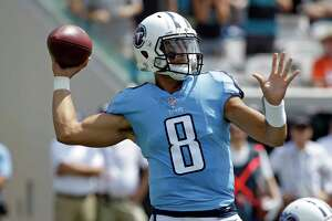 Tennessee Titans quarterback Marcus Mariota (8) throws a pass against the Jacksonville Jaguars during the first half of an NFL football game, Sunday, Sept. 17, 2017, in Jacksonville, Fla. (AP Photo/John Raoux)