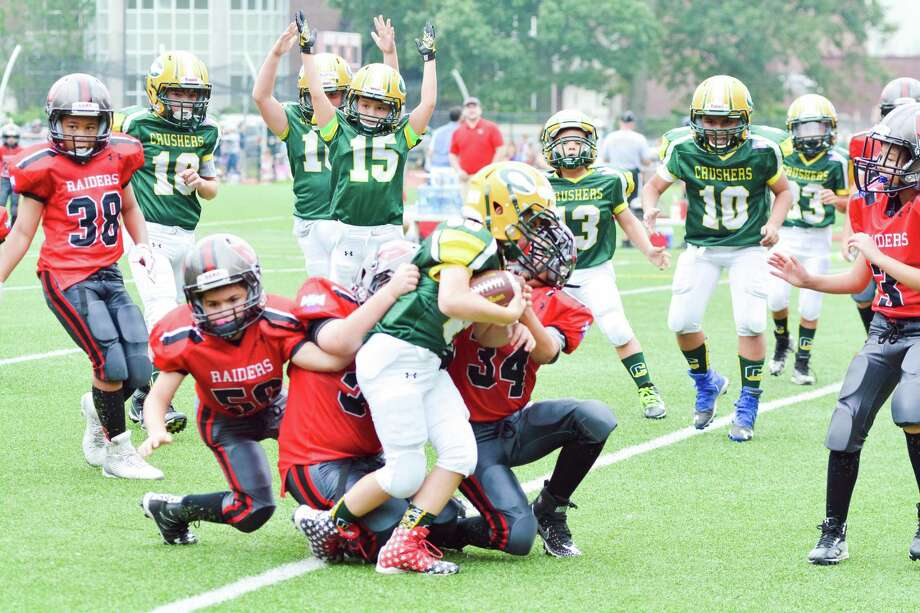 Cos Cob's Nicholas Nostro fights his way into the end zone for a touchdown against the BANC Raiders on Sunday, Sept. 17, 2017. Photo: Contributed Photo / Contributed Photo / Greenwich Time Contributed