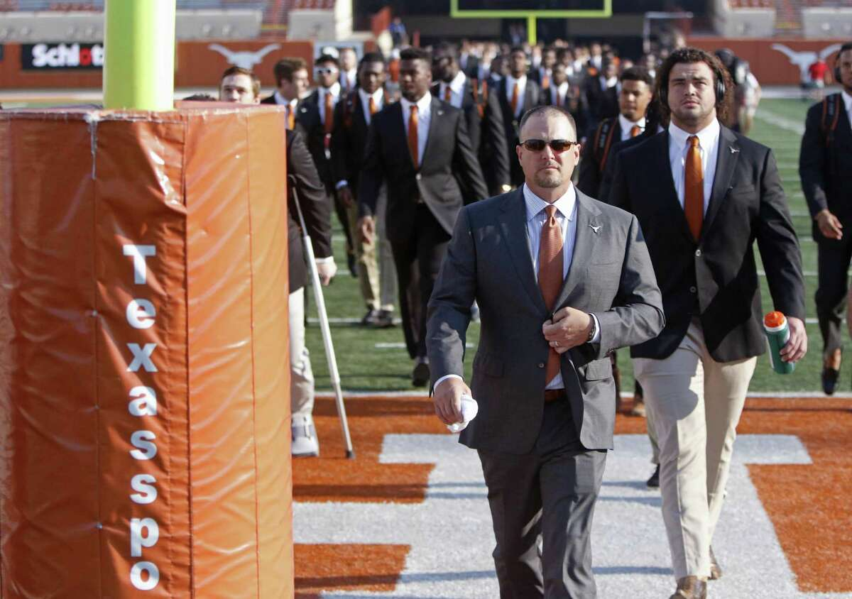 Texas coach Tom Herman (front) walks on the field with offensive lineman Connor Williams and the rest of the Longhorns before the start of the game against Maryland on Sept. 2, 2017, in Austin.