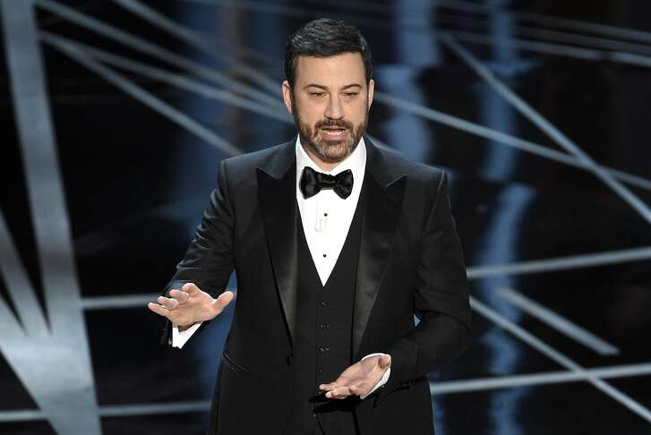 "FILE - In this Sunday, Feb. 26, 2017, file photo, host Jimmy Kimmel speaks at the Oscars at the Dolby Theatre in Los Angeles. Kimmel says his newborn son is home and doing great after open-heart surgery. A tearful Kimmel turned his show's monologue Monday, May 1, into an emotional recounting of the crisis with what Kimmel called a ""happy ending."" (Photo by Chris Pizzello/Invision/AP, File)"