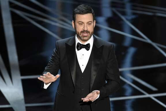 """FILE - In this Sunday, Feb. 26, 2017, file photo, host Jimmy Kimmel speaks at the Oscars at the Dolby Theatre in Los Angeles. Kimmel says his newborn son is home and doing great after open-heart surgery. A tearful Kimmel turned his show's monologue Monday, May 1, into an emotional recounting of the crisis with what Kimmel called a """"happy ending."""" (Photo by Chris Pizzello/Invision/AP, File)"""