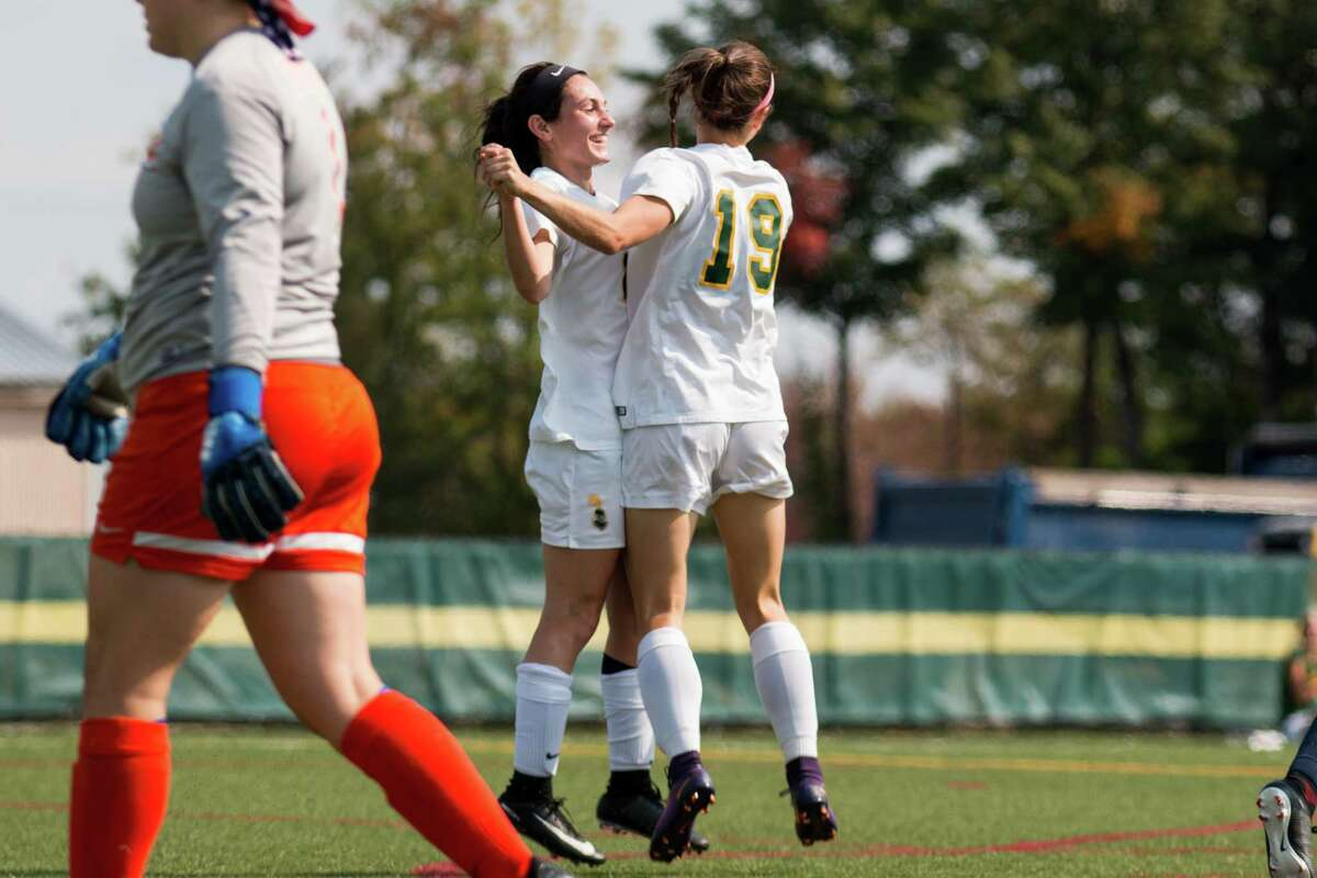 Shaker High graduate Camryn Careccia, left, of the Clarkson women's soccer team celebrates with a teammate. (Courtesy of Clarkson)