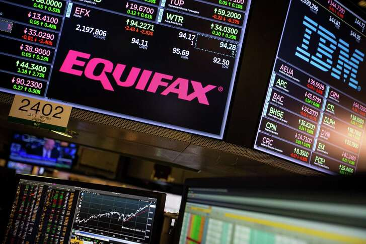 A monitor displays Equifax Inc. signage on the floor of the New York Stock Exchange (NYSE) in New York, U.S., on Friday, Sept. 15.