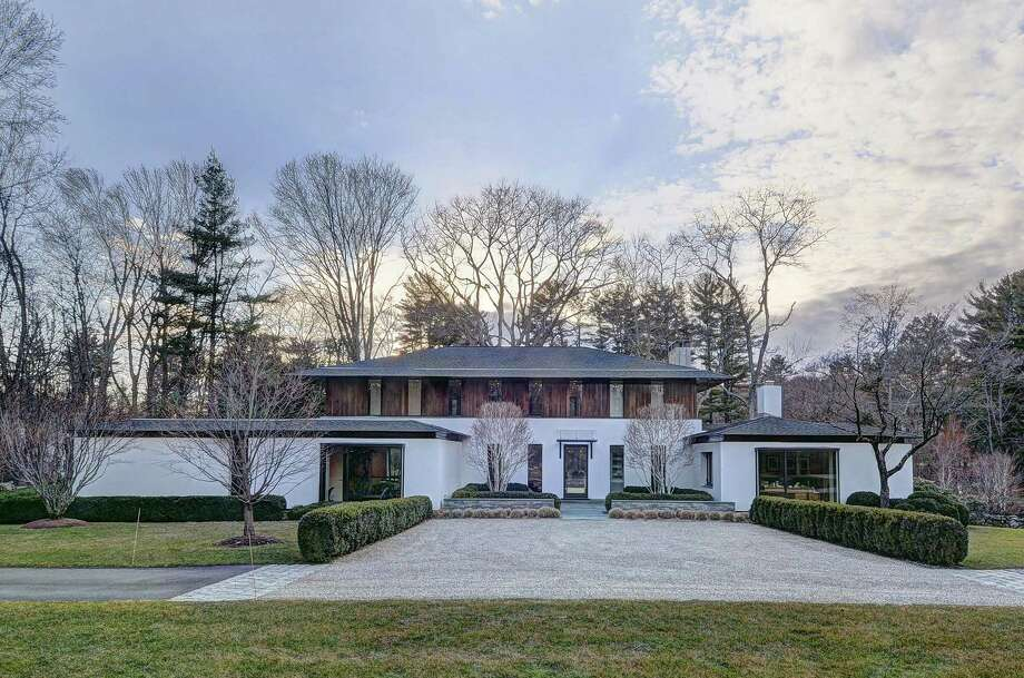 The 12-room modern house at 131 Hemlock Hill Road has a motor court at the front entrance and ample parking elsewhere for guests. Photo: Contributed Photos