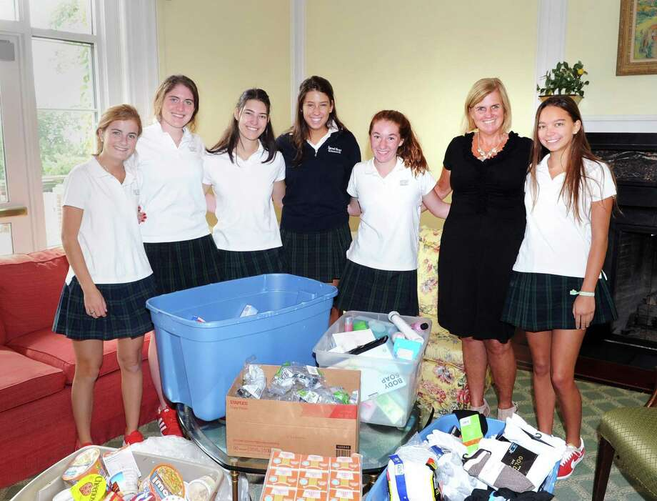 Sacred Heart Greenwich students from left, Kathryn Goodfriend, 17, Katie Muccia, 17, Jillian Larkin, 17, Mary Jane Tranfo, 18, Delaney Servick, 14, Kerry Bader - Sacred Heart Greenwich director of community services, and Ava Bloom, 17, with the relief supplies that they collected as part of a student-led effort to help those affected by Hurricanes Harvey and Irma, at Sacred Heart Greenwich, Conn., Wednesday, Sept. 20, 2017. Photo: Bob Luckey Jr. / Hearst Connecticut Media / Greenwich Time