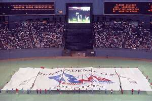 Houston Proud unveils a Texas sesquicentennial flag at the Astrodome to mark the Astros winning the NL West, Oct. 3, 1986.