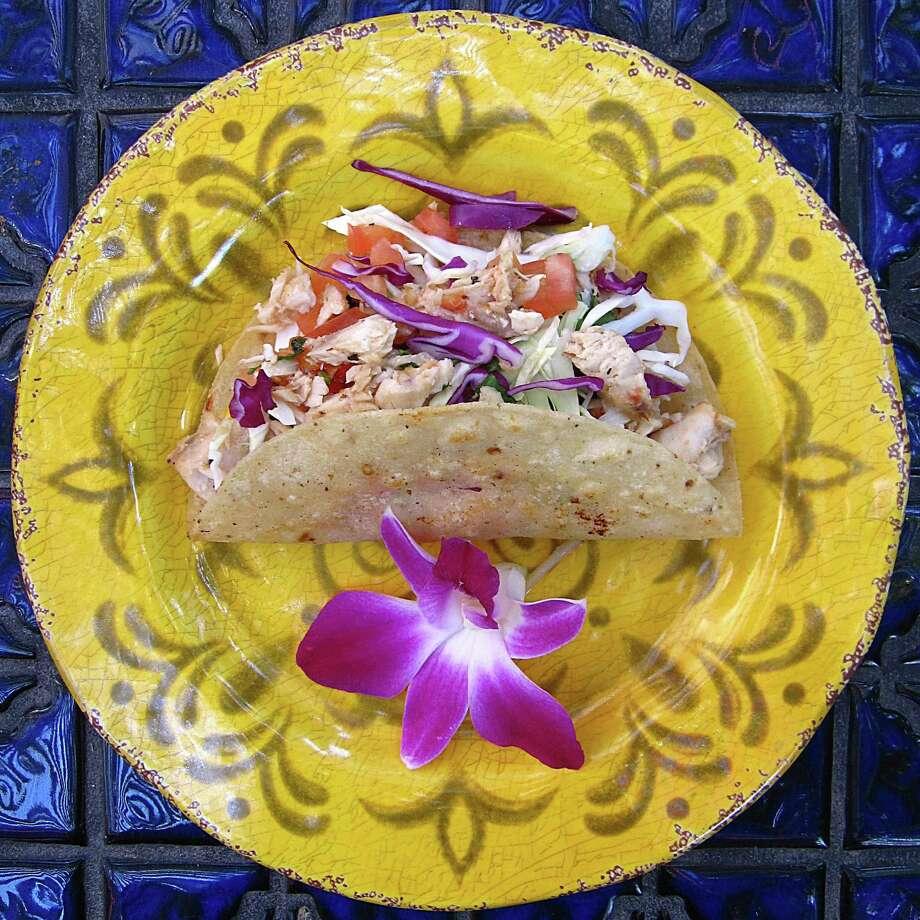 Taco of the Week: Mahi-Mahi taco with cabbage on a fried corn tortilla from La Fogata. Photo: Mike Sutter /San Antonio Express-News
