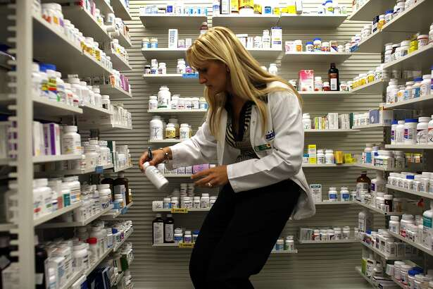 MIAMI - AUGUST 07: A Publix Supermarket pharmacy manager retrieves a bottle of antibiotics from the shelf August 7, 2007 in Miami, Florida. Publix has decided to start giving away seven commonly prescribed antibiotics for free. The oral antibiotics will be available at no cost to any customers with a prescription as often as they need it. Publix will offer 14-day supplies of the seven drugs at all of the company's pharmacies. The supermarket chain operates 684 pharmacies in five states. (Photo by Joe Raedle/Getty Images)