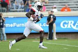 UConn running back Kevin Mensah scores a touchdown against Virginia last week in Charlottesville, Va.