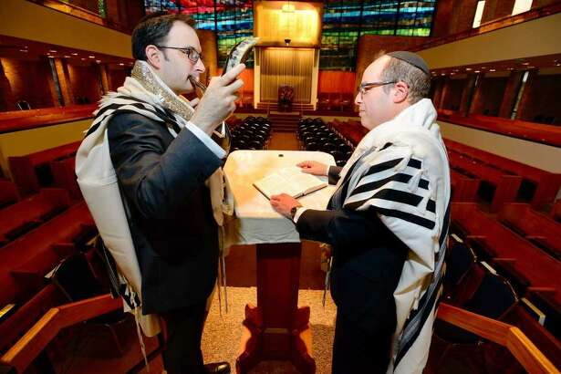 Cantor Rafael Bokow and Rabbi Daniel Cohen prepare for Rosh Hashanah services at Agudath Sholom Synagogue in Stamford on Wednesday. Rosh Hashanah