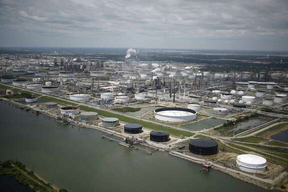 Oil refinery storage tanks stand in this aerial photograph taken above Texas City, Texas, U.S., on Wednesday, Aug. 30, 2017. Unprecedented flooding from the Category 4 storm that slammed into the state's coast last week, sending gasoline prices surging as oil refineries shut, may also set a record for rainfall in the contiguous U.S., the weather service said Tuesday. Photographer: Luke Sharrett/Bloomberg