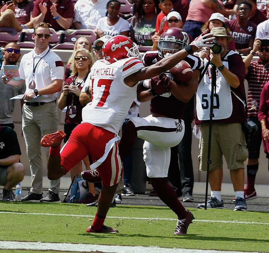 Christian Kirk (3)  of the Texas A&M Aggies can't hold onto the pass as Magnolia West alum Damar'ren Mitchell (17) of the Louisiana-Lafayette Ragin Cajuns defends at Kyle Field on September 16, 2017 in College Station. Photo: Bob Levey, Stringer / 2017 Getty Images