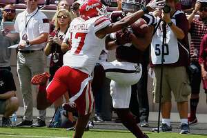 Christian Kirk (3)  of the Texas A&M Aggies can't hold onto the pass as Magnolia West alum Damar'ren Mitchell (17) of the Louisiana-Lafayette Ragin Cajuns defends at Kyle Field on September 16, 2017 in College Station.