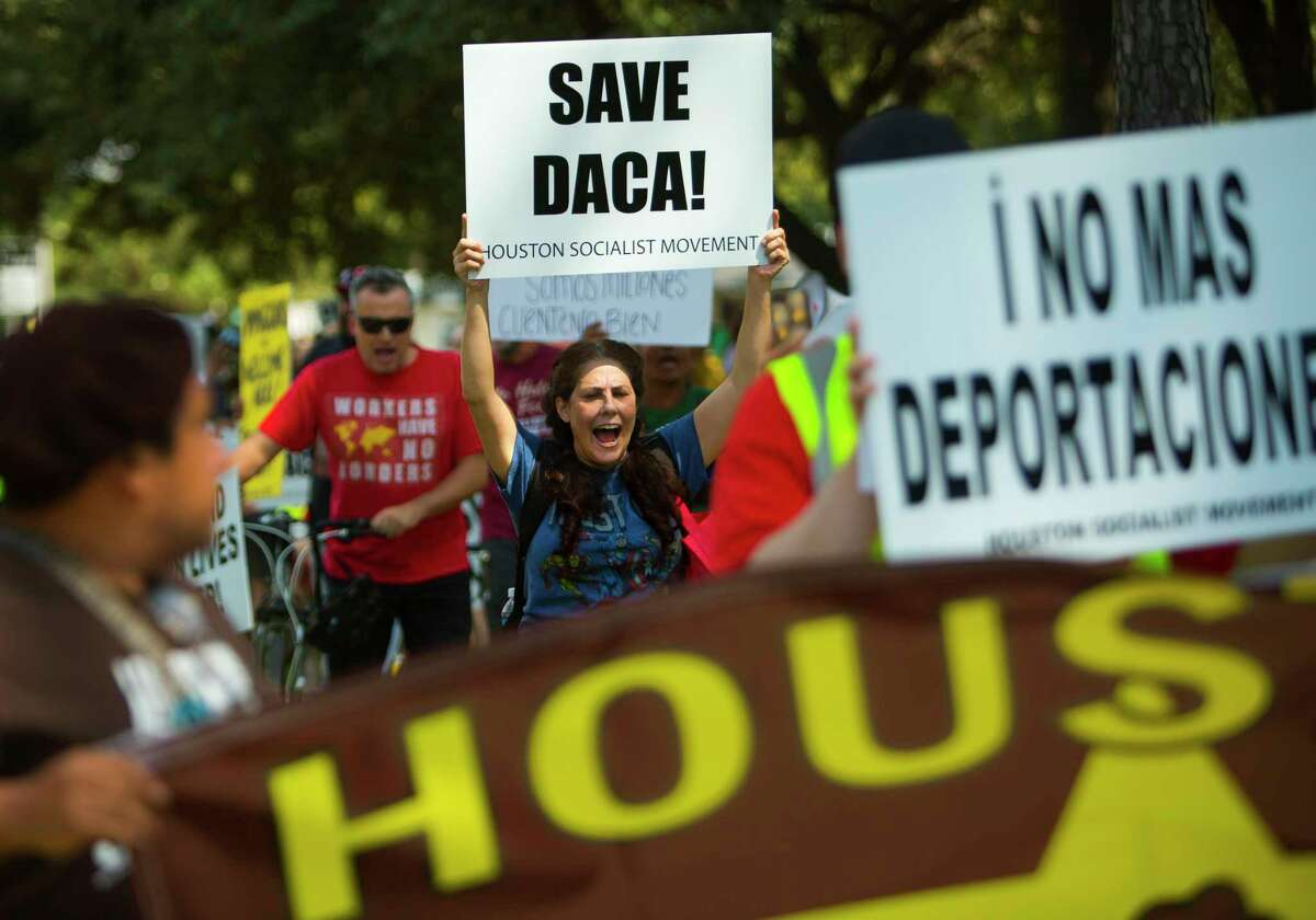 University of Houston Clear Lake teacher Angela Miller chants during a march in support of DACA recipients on Sept. 16, 2017, in Houston. (Annie Mulligan / For the Houston Chronicle)