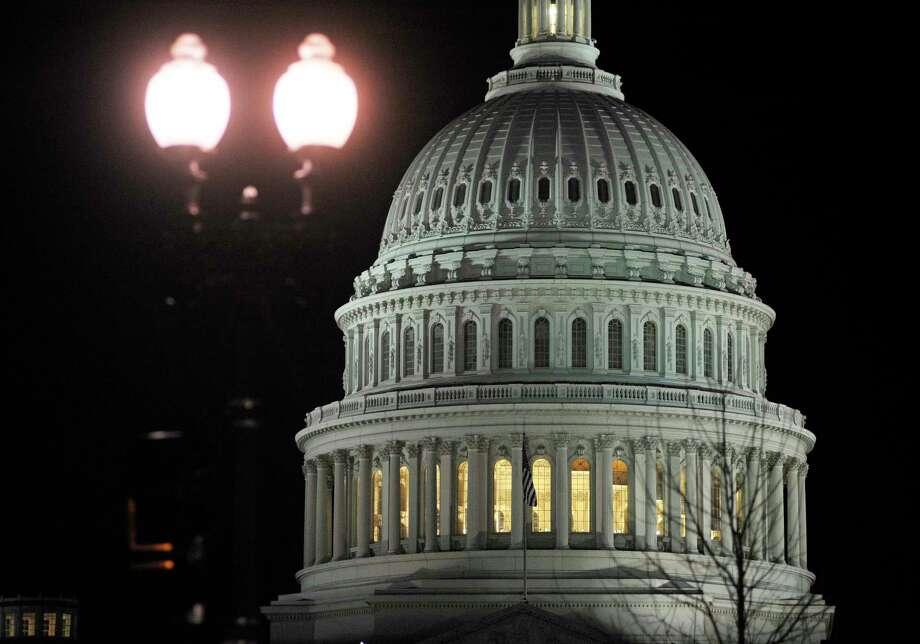 The U.S. Capitol in Washington. (Associated Press Photo) Photo: Cliff Owen, FRE / FR170079 AP