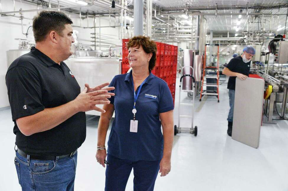 Dairy farmer Jeff King, left, and National Grid regional executive Laurie Poltynski in King Brothers Dairy's new bottling plant Wednesday Sept. 20, 2017 in Schuylerville, NY. (John Carl D'Annibale / Times Union)