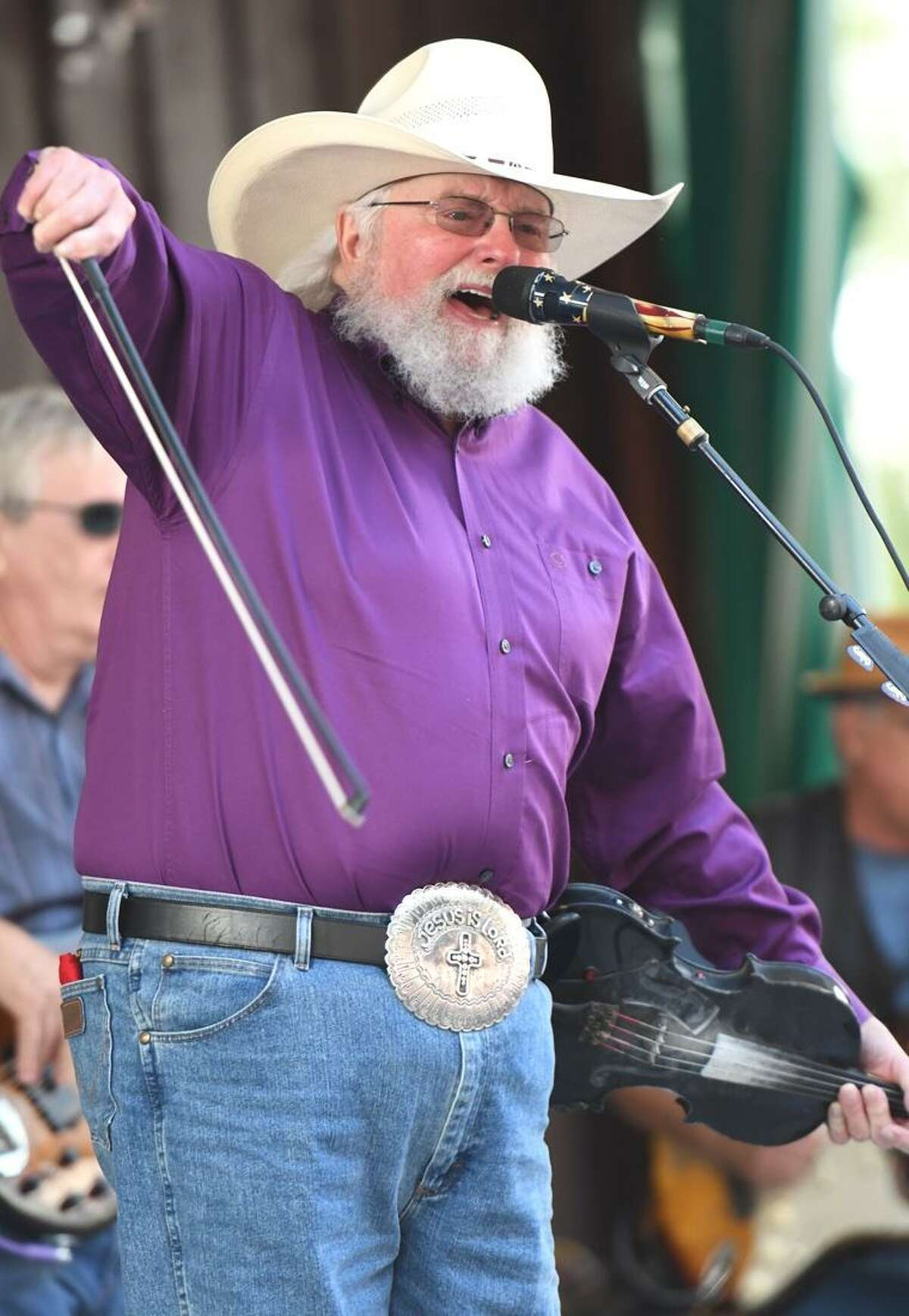 """Singer, songwriter and multi-instrumentalist, Charlie Daniels is shown in action during his recent performance at the Indian Ranch Amphitheater in Webster, Massachusetts on Sept. 9. The 80-year old musician, perhaps best known for his number one country hit ?""""The Devil Went Down To Georgia,?"""" has been an active singer, musician and touring artist since the 1950?'s. He was inducted into the Grand Ole Opry on Jan. 24, 2008and the ?""""Musicians Hall of Fame and Museum?"""" in 2009. Daniels was inducted into the ?""""Country Music Hall"""" of Fame in 2016. To learn more about the CDB 45th Anniversary Fiddle Sweepstakes, visit www.charliedaniels.com"""