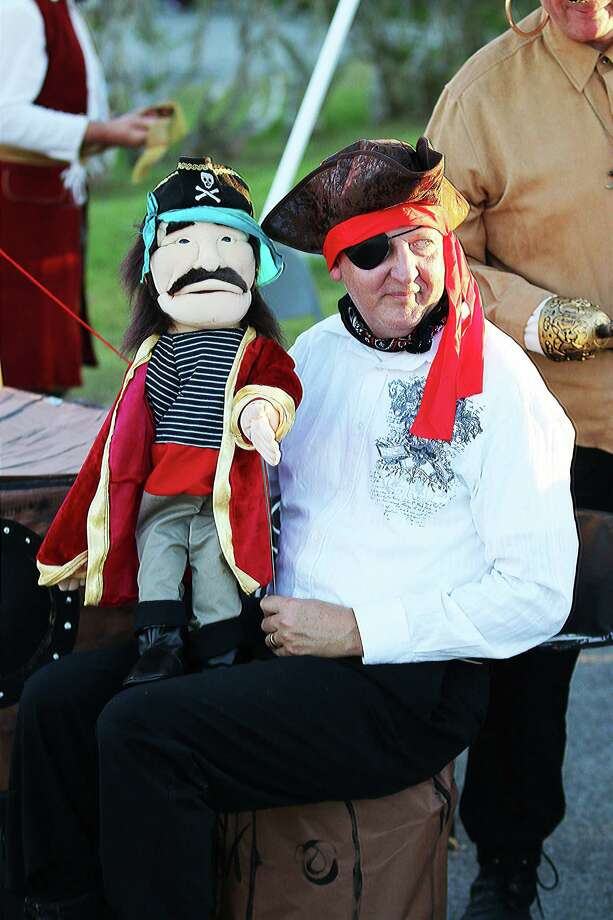Ed Husk, principal of Northside Elementary, donned a pirate costume for his campus's booth at last year's Treat Street in Cleveland. This year is expected to have just as many booths as in previous years. The biggest change this year is location; Treat Street is moving to the Cleveland Civic Center. Photo: David Taylor