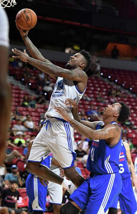 LAS VEGAS, NV - JULY 08:  Jordan Bell #2 of the Golden State Warriors drives to the basket against Isaiah Miles #41 of the Philadelphia 76ers during the 2017 Summer League at the Thomas & Mack Center on July 8, 2017 in Las Vegas, Nevada. Philadelphia won 95-93. NOTE TO USER: User expressly acknowledges and agrees that, by downloading and or using this photograph, User is consenting to the terms and conditions of the Getty Images License Agreement.  (Photo by Ethan Miller/Getty Images) Photo: Ethan Miller / Getty Images / 2017 Getty Images