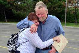 Former Bridgeport City Councilman Bob Halstead reunites with Susan Akie-Mote, of Long Island, at the Bridgeport Ferry Terminal in Bridgeport, Conn., on Wednesday Sept. 20, 2017. When Halstead was 16, he found Susan, who was an hours old baby, left inside a hat box. Susan was eventually adopted and recently started searcing for her birth mother. That search led her to find Halstead on Facebook last week.