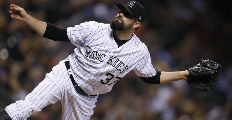 Colorado Rockies reliever Pat Neshek watches a pitch to Arizona Diamondbacks' J.D. Martinez during the seventh inning of a baseball game Saturday, Sept. 2, 2017, in Denver. The Diamondbacks won 6-2. (AP Photo/David Zalubowski) Photo: David Zalubowski/Associated Press
