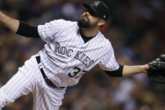 Colorado Rockies reliever Pat Neshek watches a pitch to Arizona Diamondbacks' J.D. Martinez during the seventh inning of a baseball game Saturday, Sept. 2, 2017, in Denver. The Diamondbacks won 6-2. (AP Photo/David Zalubowski)