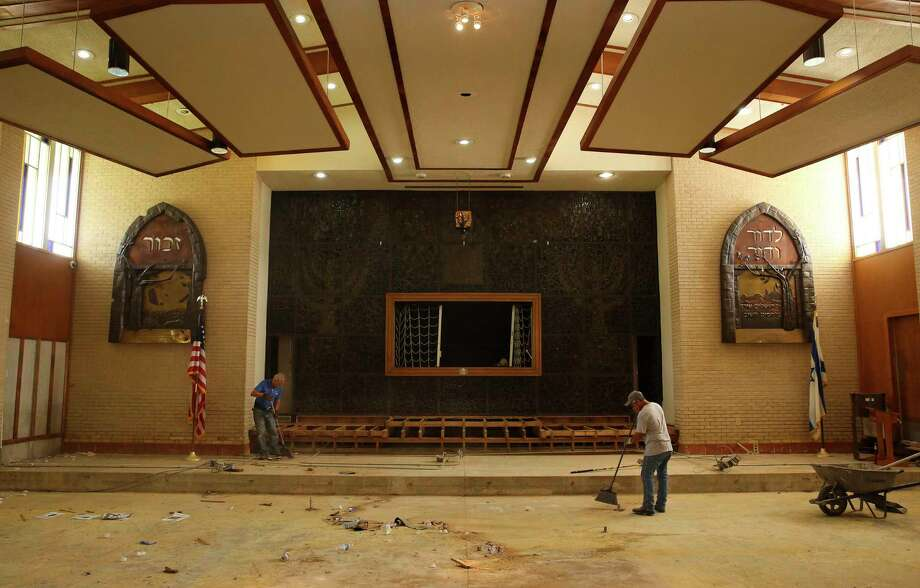 Contractors Juan Nateras, left, and Uvaldo Cabazos clean up the United Orthodox Synagogues of Houston temple, where they usually have the celebration of Rosh Hashanah. Due to the flood damage, the synagogue had to move its celebration to a community hall. Photo: Yi-Chin Lee, Staff / © 2017  Houston Chronicle