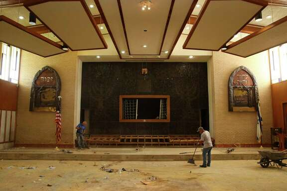 Contractors Juan Nateras, left, and Uvaldo Cabazos clean up the United Orthodox Synagogues of Houston temple, where they usually have the celebration of Rosh Hashanah. Due to the flood damage, the synagogue had to move its celebration to a community hall.