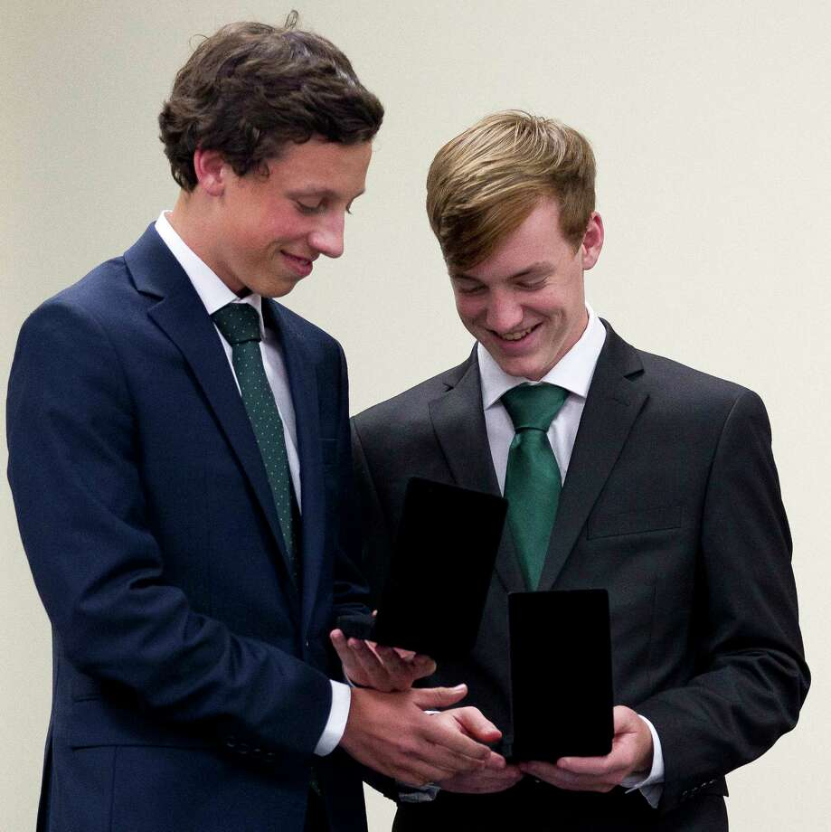 Sam Lyons, right, shares a laugh as he and his brother Henry, 17, swap medals during an Congressional Medal Program ceremony honoring 10 local students from U.S. Congressman Kevin Bradyé•s 8th congressional district, Wednesday, Sept. 20, 2017, in The Woodlands. The program allows students aged 13-and-1/2 through 24 years old to participate in setting and achieving individual goals in four program areas: voluntary public service, personal development, physical fitness and expedition/exploration. Photo: Jason Fochtman, Staff Photographer / © 2017 Houston Chronicle